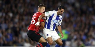 Beram Kayal of Brighton and Hove Albion is challenged by Jan Bednarek of Southampton during the Carabao Cup Second Round match