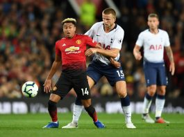 Jesse Lingard of Manchester United and Eric Dier of Tottenham Hotspur battle for possession during the Premier League match between Manchester United and Tottenham Hotspur