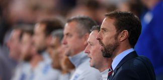 Gareth Southgate of England sings the National Anthem with his coaching staff ahead of the International Friendly match