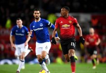 Anthony Martial of Manchester United runs with the ball alongside Andre Gomes of Everton