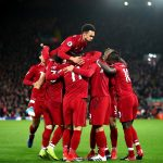 Roberto Firmino of Liverpool celebrates with team mates after scoring his sides second goal