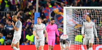 Liverpool look on dejected after Lionel Messi of Barcelona (not pictured) scores his sides second goal during the UEFA Champions League Semi Final first leg