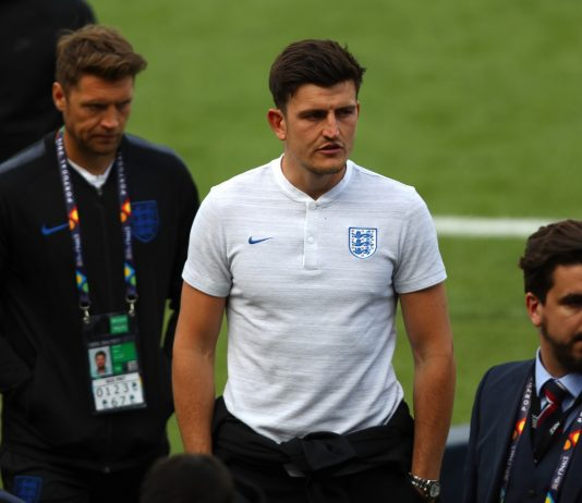 Harry Maguire walks on the pitch during England media access on the eve of their UEFA Nations League match.