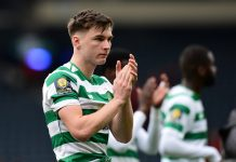 Kieran Tierney of Celtic applauds the fans