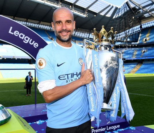 Pep Guardiola, Manager of Manchester City poses with The Premier League Trophy