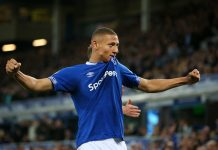 Richarlison of Everton celebrates after his team's first goal, an own goal by Ben Mee of Burnley during the Premier League match between Everton FC and Burnley FC