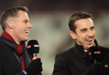 Pundits Jamie Carragher (L) and Gary Neville laugh prior to a Premier League match