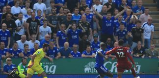 Liverpool goalkeeper Alisson reacts after being dispossessed by Kelechi Iheanacho of Leicester City