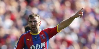 James McArthur of Crystal Palace shouts orders to his team mates as it looks like he is missing his front teeth after a previous challenge