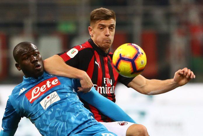 Kalidou Koulibaly of SSC Napoli competes for the ball with Krzysztof Piatek of AC Milan
