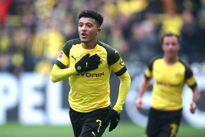 Jadon Sancho of Borussia Dortmund celebrates after scoring his team's first goal during the Bundesliga match between Borussia Dortmund and 1. FSV Mainz 05