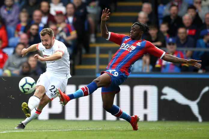 Aaron Wan-Bissaka of Crystal Palace is challenged by Ryan Fraser of AFC Bournemouth during the Premier League match between Crystal Palace and AFC Bournemouth