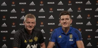 Harry Maguire of Manchester United poses with Manager Ole Gunnar Solskjaer after signing for the club