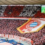 Fans of Bayern Munich show their logo prior to the DFB Cup final between RB Leipzig and Bayern Munchen at Olympiastadion