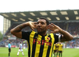 Troy Deeney of Watford celebrates after scoring his sides second goal during the Premier League match between Burnley FC and Watford FC at Turf Moor